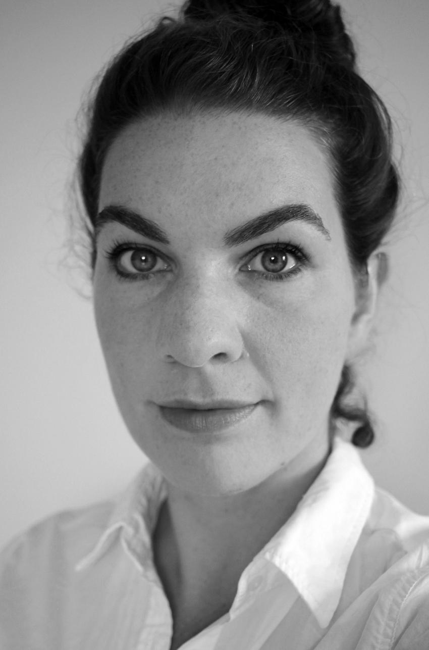 Dr. Laurette Burgholzer